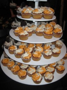Creamsicle and chocolate cupcakes with Oreo frosting and a cookie on top.Photo by: Sandra Carr