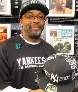 Spike Lee wearing New York Yankees gear.
